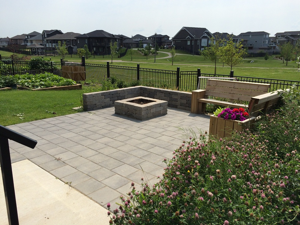 paving stone patio, firepit and seating area